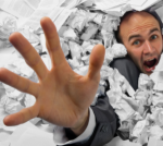 man drowning in paper